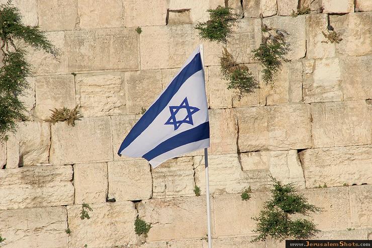 http://www.jerusalemshots.com/b/Jerusalem-Israel/Israel-flag-kotel.jpg